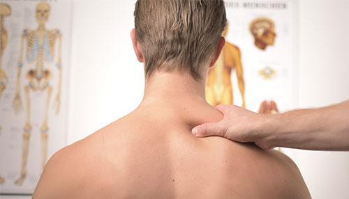 individual receiving shoulder assessment