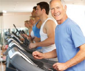 Man smiling while walking on treadmill